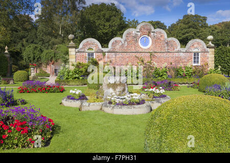 The Victorian Parterre Garden at Erddig, Wrexham, Wales, in September. The clock on the cusped gable wall was brought - Stock Photo