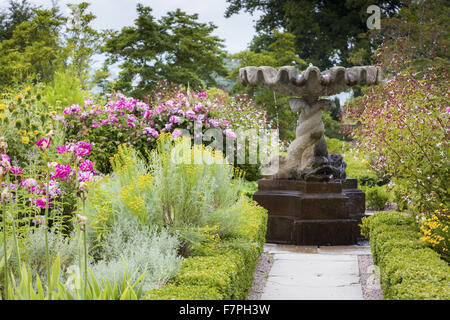 The Round Garden in full bloom in July, Bodnant Garden, Conwy, Wales. - Stock Photo