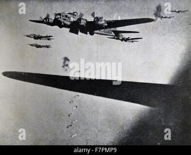 Photograph of Boeing B-17 Flying Fortresses dropping bombs during the Second World War. Dated 1941 - Stock Photo