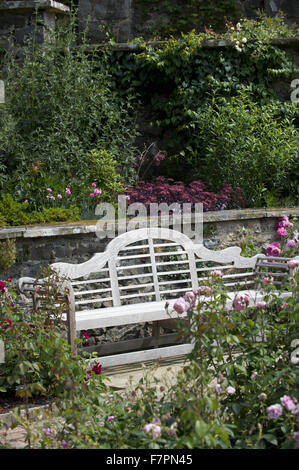 Garden bench at Bodnant Garden, Clwyd, Wales. Created by five generations of one family, Bodnant sits perfectly - Stock Photo