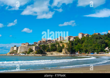 Mala plaza, waterfront with small beach, with Stari Grad the old town in background, Ulcinj, Ulqin, Montenegro, - Stock Photo