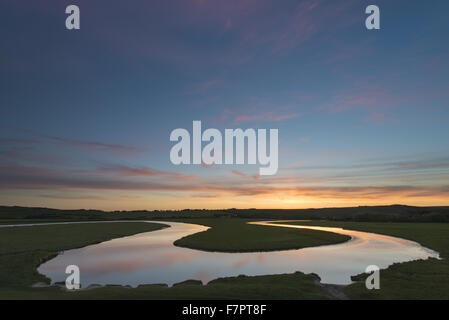 Sunset reflected in the meanders of the Cuckmere River, Cuckmere Valley, East Sussex. - Stock Photo