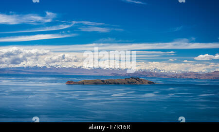 Wide angle view from offshore of the Island of the Moon, Titicaca Lake, among the most scenic travel destination - Stock Photo