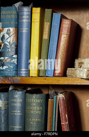 Books on shelves in the Nursery at Eyam Hall and Craft Centre, Derbyshire. Eyam Hall is an unspoilt example of a gritstone Jacobean manor house, set within a walled garden.