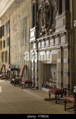 Draped tapestries framing an open door in the Great High Chamber, Hardwick House, Derbyshire. The walls of the Long - Stock Photo