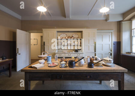 A display of crockery and other objects on the kitchen table at Standen House and Garden, West Sussex. The Philip - Stock Photo