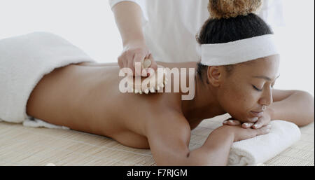 African Woman Receiving Back Massage - Stock Photo