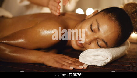Woman Having Therapy Massage Of Back - Stock Photo