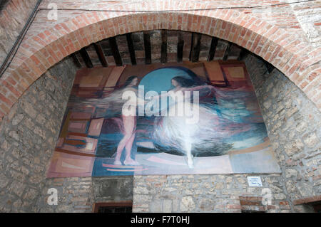 Mugnano, village of the painted walls, fresco on the wall by Franco Troiani, Umbria, Italy - Stock Photo