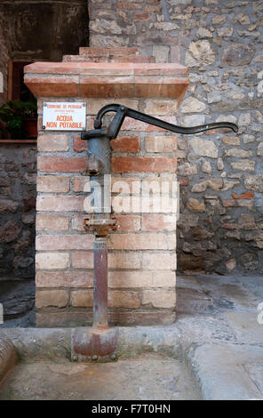 Old fountain in Mugnano, village of the painted walls, Umbria, Italy - Stock Photo