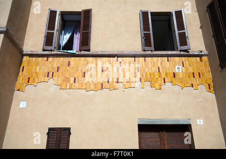 Mugnano, village of the painted walls, fresco on the wall by Sara Sargentini, Umbria, Italy - Stock Photo