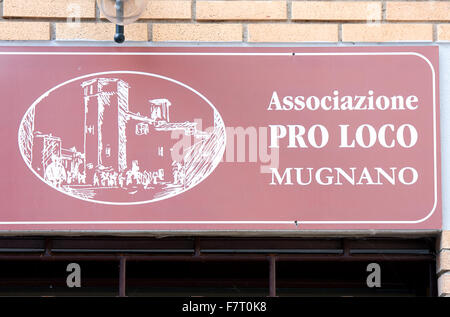 Mugnano, village of the painted walls, tourist sign about Pro Loco, Umbria, Italy - Stock Photo