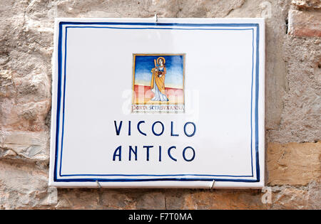 Mugnano, village of the painted walls, painted street sign, Umbria, Italy - Stock Photo