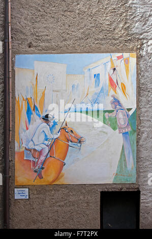 Mugnano, village of the painted walls, fresco on the wall by Angelo Barbaro, Umbria, Italy - Stock Photo