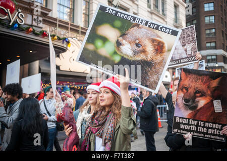 Animal rights activists protest the sale of fur on Black Friday, traditionally known as Fur Free Friday, on Friday, - Stock Photo