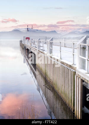 Ullswater jetty at Pooley Bridge on a frosty winter morning. - Stock Photo