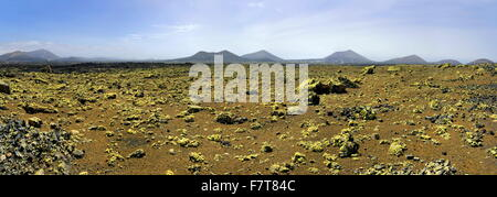 Caldera Colorada, moss covered lava rock, volcanic mountains, Mancha Blanca, Lanzarote, Canary Islands, Spain - Stock Photo