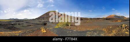 Caldera Colorada with lava, volcanic mountains, Mancha Blanca, Lanzarote, Canary Islands, Spain - Stock Photo