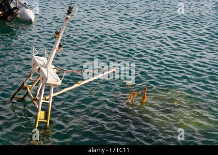 Sunken fish trawler in the harbor of Tarifa, Spain - Stock Photo