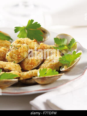 A dish of delicious battered clams with garlic - Stock Photo
