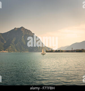 In the picture a view of Lake Iseo from the city of Lovere, on the side of a sailboat. - Stock Photo