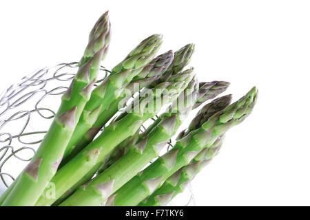 Fresh asparagus in a metal basket - Stock Photo