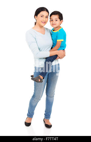 pretty Indian woman holding her son on white background - Stock Photo