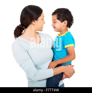 beautiful Indian mother and son looking at each other on white background - Stock Photo