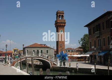 Murano, Italy, June 6 2014: San Pietro Martire Bell Tower and the famous blue glass sculpture from Italian artist - Stock Photo