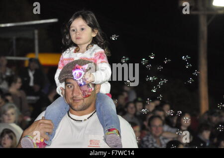YOUNG GIRL ON DADS SHOULDERS - Stock Photo