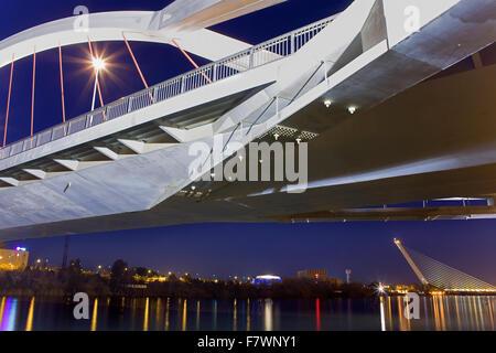 The river Guadalquivir. Bridge of La Barqueta and in background Bridge of the Alamillo . Seville, Andalusia, Spain. - Stock Photo