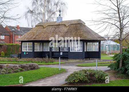 A thatched pavilion in Victoria Park Stafford Staffordshire England UK - Stock Photo