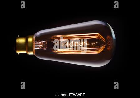 Ideas concept in a filament lightbulb. - Stock Photo