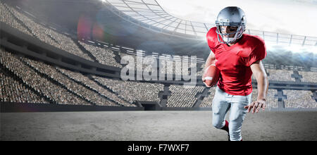 Composite image of sportsman running while playing american football - Stock Photo