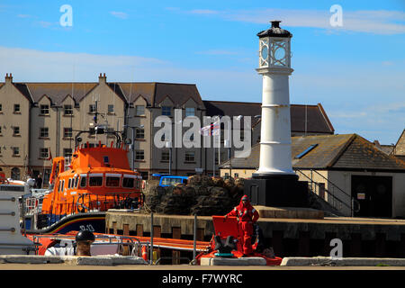 RNLI lifeboat and lighthouse The Basin Kirkwall Harbour Orkney Islands Scotland UK - Stock Photo