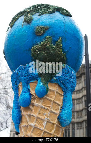 March to demand global leaders take action to combat Climate Change. Sculpture of a melting world as an ice cream. - Stock Photo