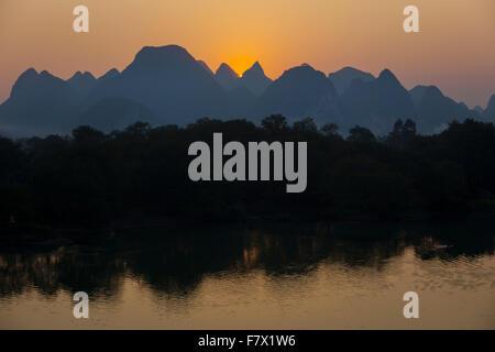 Limestone Karst Formations reflected in River Li at Sunset Guilin Region Guangxi, China LA008309 - Stock Photo
