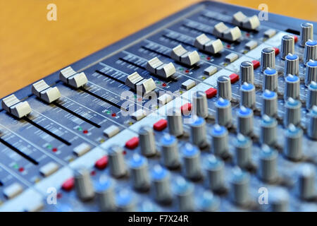 Detail with adjusting knobs on a professional audio mixer - Stock Photo