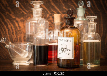 Glass bottles with poison label - Stock Photo