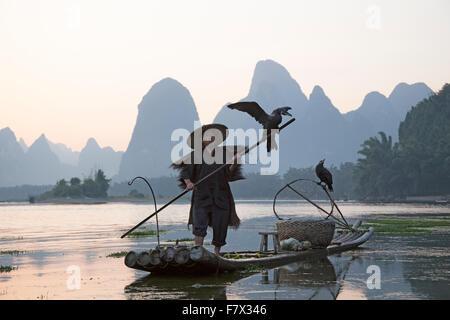 Cormorant Fisherman on River Li Guilin Region Guangxi, China LA008353 - Stock Photo