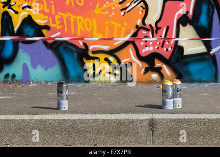 Used graffiti spray cans on sidewalk - Stock Photo