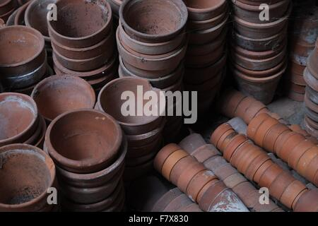 Plant pots in a potting shed - Stock Photo