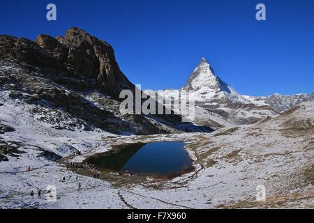 Lake Riffelsee and Matterhorn in autumn - Stock Photo