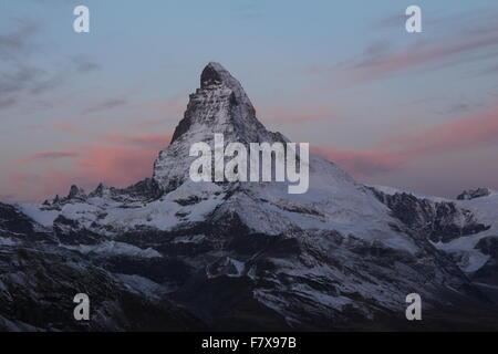 Pink clouds over the Matterhorn - Stock Photo