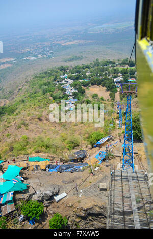 View from Ropeway - Vast arid landscape of Pavagadh Hill dotted with tarpaulin roofed shops and trees Panchmahal, - Stock Photo