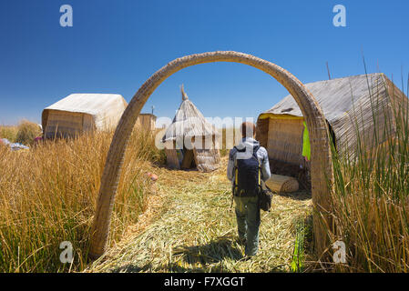 Tourist roaming in a village of the Uros Islands, entirely made of Totora Reeds, floating on Titicaca Lake, among - Stock Photo