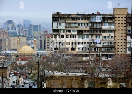 Modern mosque and old apartments with view over Baku, capital of Azerbaijan - Stock Photo
