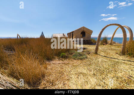Village of the Uros Islands, entirely made of Totora Reeds, floating on Titicaca Lake, among the most interesting - Stock Photo