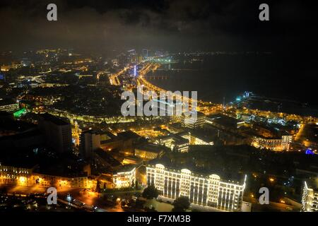 View over the bay in Baku, capital city of Azerbaijan, at night from the Royal Suite of the Fairmont Hotel - Stock Photo