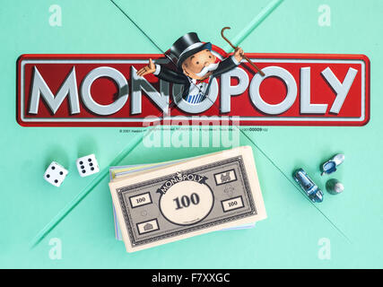 English Edition of Monopoly showing The Logo,  The classic trading game from Hasbro was first introduced to America - Stock Photo